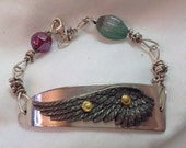 Recycled knife and sterling silver women's bracelet with wing