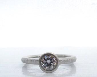 Pacific Ring wedding set 950 palladium and Forever One moissanite bezel set engagement ring