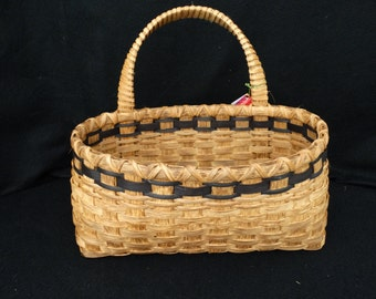 Hand Woven Basket in traditional style with handle in back. Storage  Basket. Wall basket. Baskets. Hand made baskets in traditional design.