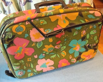 Vintage mod cloth child size flowered suitcase with zip close and key lock