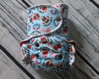 One Size Stay Dry Overnight Fitted Cloth Diaper in Football Ooga Booga by Soothe Baby