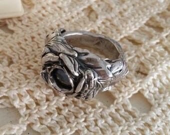 artisan fine silver rose ring boasts sculpted leaves and deep blue green glass orb center