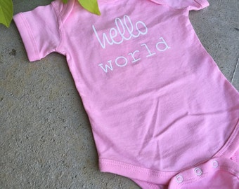 H E L L O world ... newborn onesie ... pink