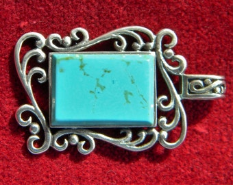 Turquoise pendant in Sterling scrollwork