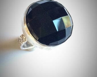 Sterling silver and faceted round black onyx ring