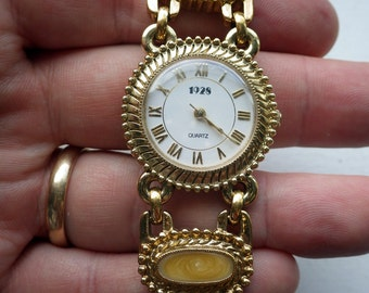 1928 brand Fancy Bracelet Watch - enamel design.