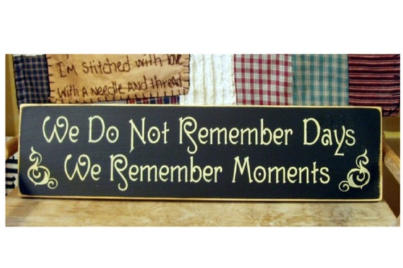 We do not remember days we remember moments wood sign
