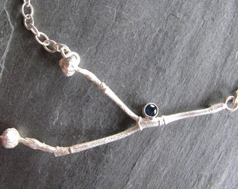 Dogwood Twig and Sapphire Necklace in Sterling Silver