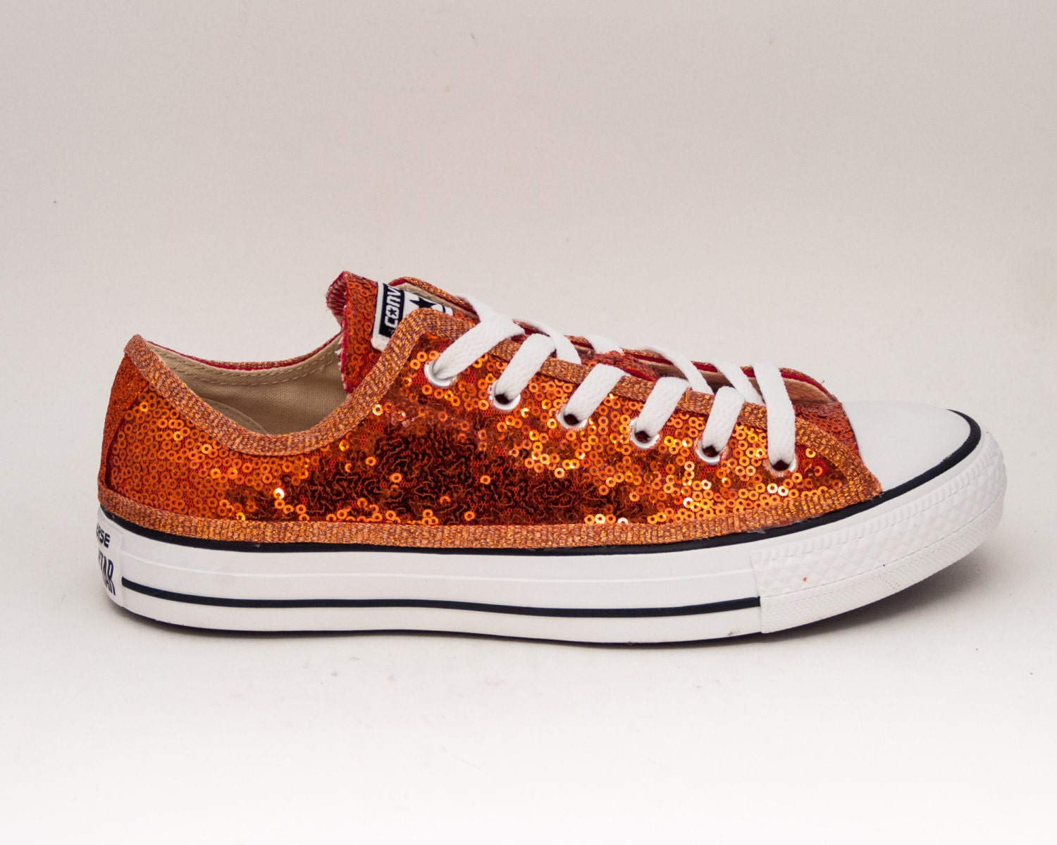 Womens Sparkly Glitter Bling Shoes Sneakers high low Heels Ballet Flats Converse Toms Mens Kids Bride Bridesmaid Bridal Gift Prom Birthday 16 pumps peep toe. Women's Sparkly Tangerine Orange Glitter Pumps high low Heels Wedding bride Shoes. Glitter Shoe Co is a Custom Design Studio in Miami, Florida. We specialize in custom footwear.