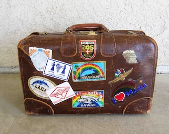Vintage Brown Leather Suitcase with Travel Stickers. Circa 1960's.