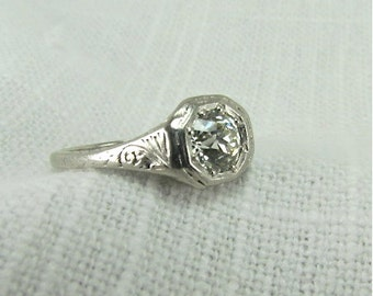 On Sale!  Appraisal Value: 9400.  Circa 1920's Platinum Engagement Ring set with 0.83 CT VS 1 Old European Cut Diamond