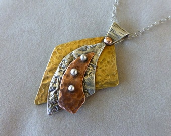 Reticulated Sterling, Brass and Copper Pendant