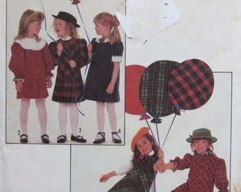 Simplicity 8823 Uncut Vintage Sewing Pattern Little Girls Size 5 Bias Dress with Neck Sleeve and Skirt Variations 1988