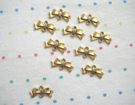 Antique gold bow connector charms finish