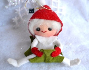 Vintage Christmas Ornament - Snow Pixie Riding Holly Leaf