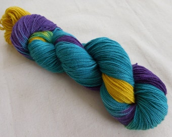 Gravitational Waves Hand-Painted Superwash Merino and Nylon Blend Sock Yarn -- Teal, Purple, Gold