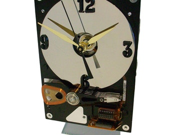 Hard Drive Clock with Acrylic Stand and Mirrored Disk Platter as the Dial.