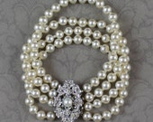 Vintage Triple Strand Faux Pearl Bracelet with Silver Filigree Rhinestone Clasp
