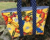 The Carmen Miranda large oilcloth tote bag with tropical fruit on yellow