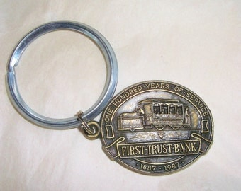 Vintage 1887 -1987 FIRST TRUST BANK Keyring • one hundred years of service • Ontario Ca
