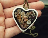 Unique hand crafted pendant featuring real shells in resin set in a porcelain heart black and white unique jewelry ooak Anita Reay