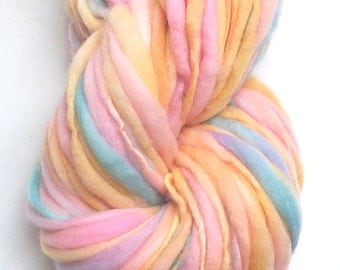 Handspun chunky yarn, 50 yards and 1.65 ounces/48 grams spun thick and thin in hand dyed merino wool