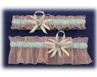 Light Pink and Blue Wedding Garter Set with Paua Charm