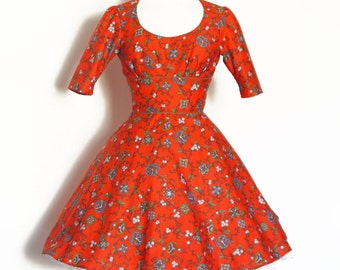 Red Moroccan Floral Twisting Scoop-neck Dress with a Flared Skirt - Made by Dig For Victory