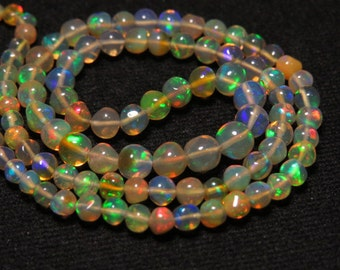 Welo Ethiopian Opal  - 13 Inches  -  Nice Quality Smooth Polished Round Ball Beads shape Full Color Full Flashy Fire size - 3 - 5 mm approx