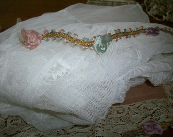 17 inches of Antique ribbon work in a silk or rayon and metal in blue/pink/lilac