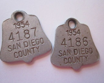 2 vintage metal dog tags - pet tags - San Diego circa 1954 - tell shaped tags