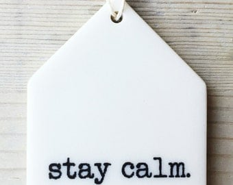 porcelain wall tag screenprinted text stay calm.