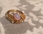 Opalite and rhinestone ring with gold leaves. Avon fits size 5.5 to 8