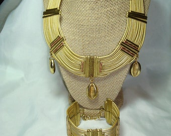Gold and Copper Colored Cowrie Necklace and Bracelet Set.