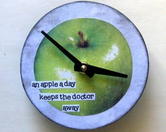 Small wall clock. Kitchen clock. Recycled CD.  Vinyl clock. Apple. An apple a day keeps the doctor away.  Clock for vegans.