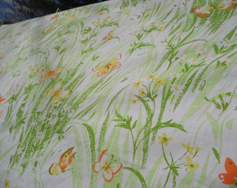 Bibb Co vintage King flat sheet white background covered in green leaves orange green and yelow butterflies white and yellow flowers