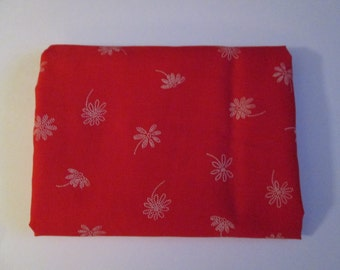 White dotted flowers on a red background, cotton blend cut of fabric for quilting, sewing or crafting projects