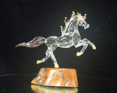 Glass horse on wood