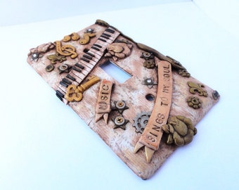 Music steampunk switch plate 3 handmade by Marie Segal
