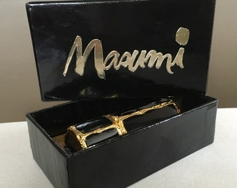 Masumi by Coty Inner Beauty purser .12 oz boxed full black rollerball applicator purse sized 1960's display use lovely metallic brutallist