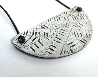Half-Circle Piano Necklace - hand carved clay and black leather