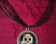 Handmade Black Sugar Skull Cabochon Necklace in Antique Silver setting.