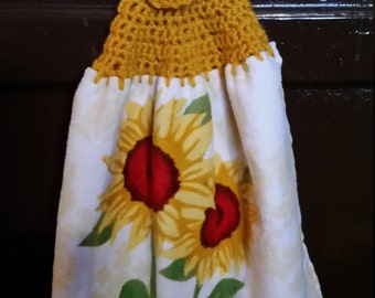 Hand crochet kitchen towel with sunflowers.