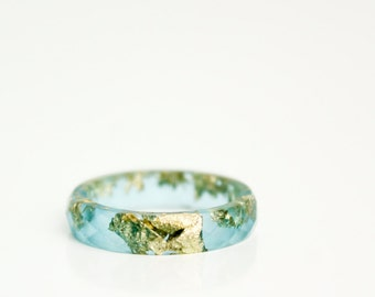 size 8.5 thin multifaceted eco resin ring | ocean blue eco resin featuring gold metallic flakes