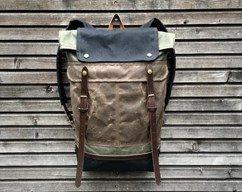 Waxed canvas backpack / rucksack with folded top and waxed canvas shoulderstrap and bottom