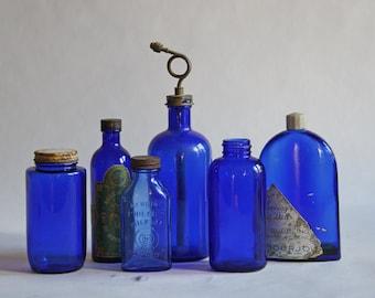 Six Vintage Cobalt Blue Glass Bottle Collection