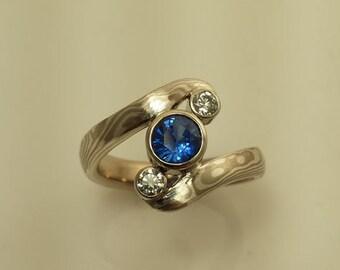 Three stone Mokume Gane engagment ring with Blue Sapphire and diamonds