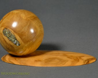 Sphere of contentment. Olive with crushed abalone inlay.