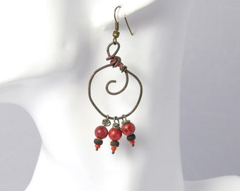 Oxidized copper wire hoops with spirals and coral beads