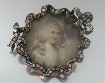 Antique Georgian Hand Painted Portrait of a Lady with Rose Cut Diamonds in a Silver Ribbon Brooch